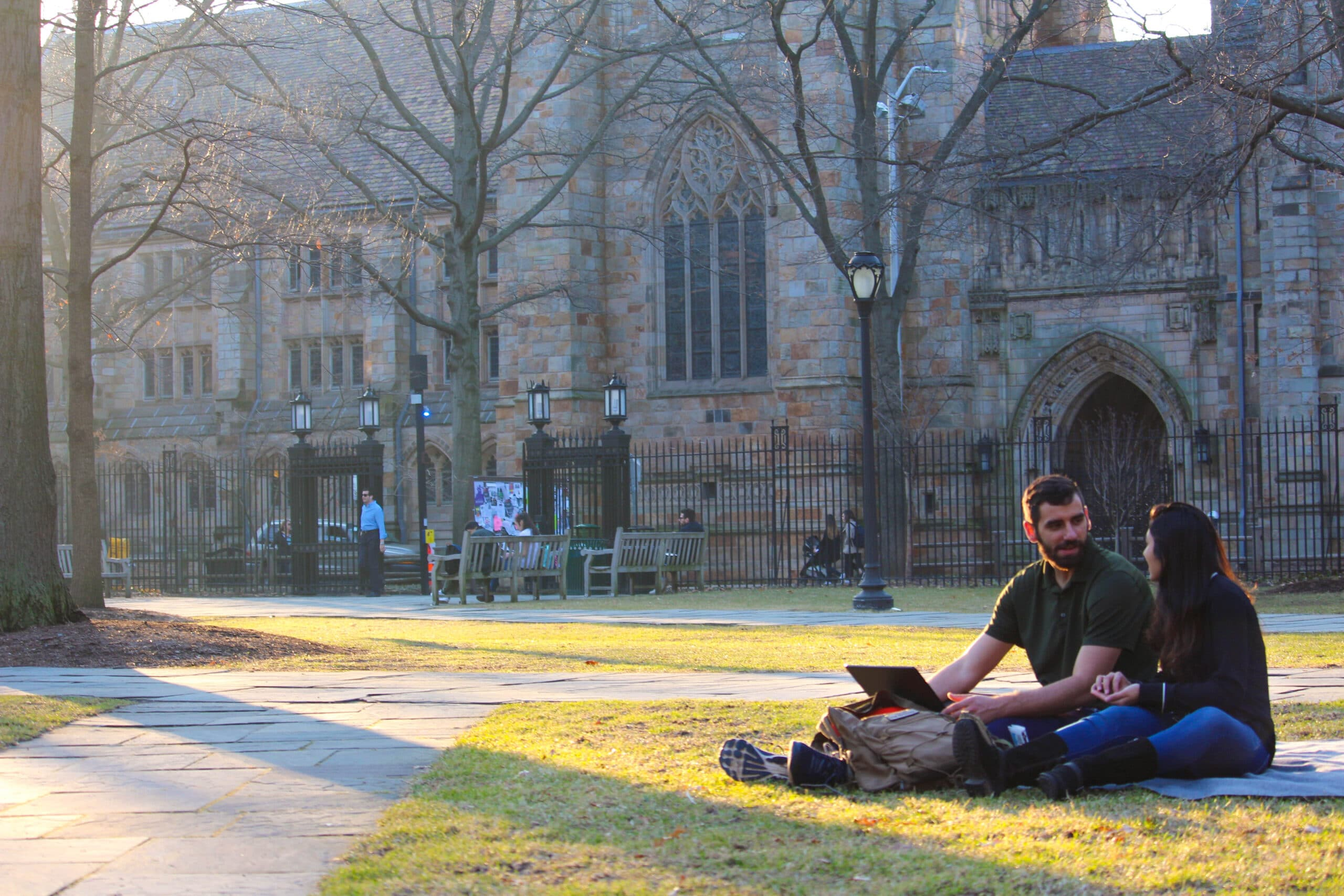 ivy league students sitting on Yale campus