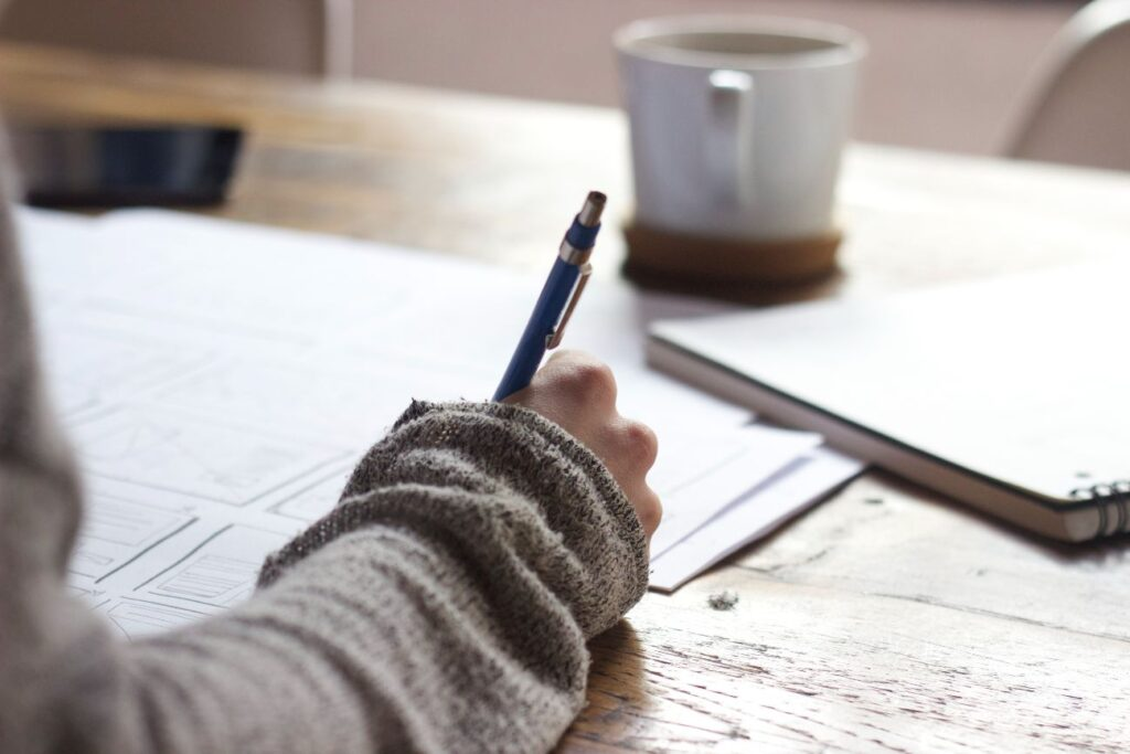 international student writing personal essay to get into college